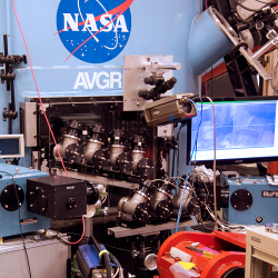 Eight 2 inch clear telescopes arranged around NASA Ames hypervelocity gun target chamber